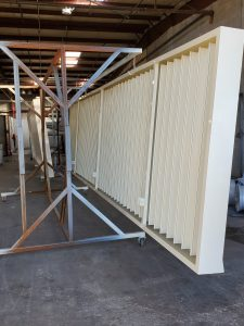 Aluminum corrugated dumpster gate. Powder coated Almond.